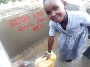 Little girl in Uganda gets safe drinking water at well